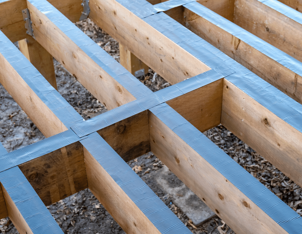 Building a deck with protective covers over the joists